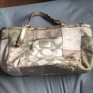 Tan and gold Coach purse. Very good used condition
